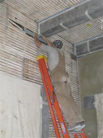 M Butkovich installing steel angle to support  end of decorative beam_thumb.JPG